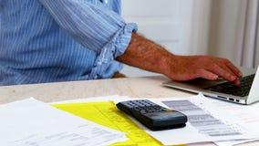 Senior man using laptop at home stock video