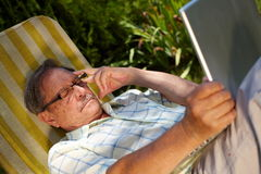 Senior man using laptop outdoor Stock Photography