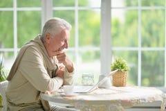 Senior man using laptop Royalty Free Stock Image