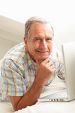 Senior Man Using Laptop Relaxing Sitting On Sofa Stock Photos
