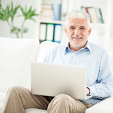 Senior Man Using Laptop Royalty Free Stock Photography
