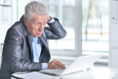 Senior man  using laptop Stock Image