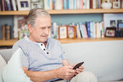Senior man using mobile phone Stock Images