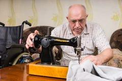Senior Man Using Old Fashioned Sewing Machine Stock Photos