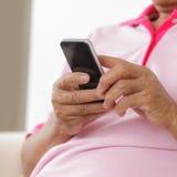 Senior man using phone Stock Images