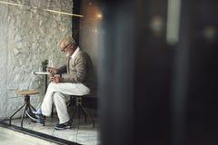 Senior Man Using Smart Phone Connection Concept Stock Image