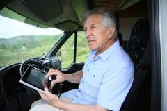 Senior man using tablet in camping car Royalty Free Stock Images