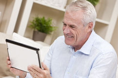 Senior Man Using Tablet Computer Stock Photos