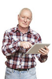 Senior man using tablet computer looking confused. On white background Stock Photography