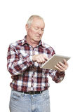 Senior man using tablet computer looking confused. On white background Royalty Free Stock Image