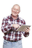 Senior man using tablet computer smiling Royalty Free Stock Images