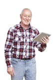 Senior man using tablet computer smiling. On white background Stock Photos