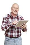 Senior man using tablet computer smiling. On white background Royalty Free Stock Photos