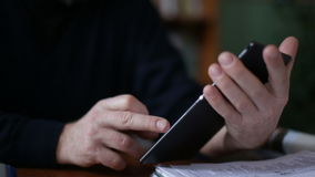 Senior man using tablet sitting on on a chair in the library stock footage