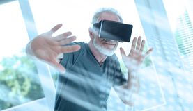 Man using a virtual reality headset; light effect. Senior man using a virtual reality headset; light effect stock photo