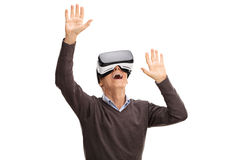 Senior man using a VR headset stock photography