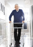 Senior Man Using Walker At Rehab Center Stock Photos