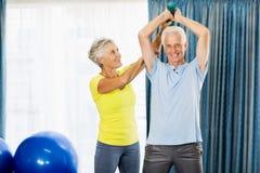 Senior man using weights Stock Images