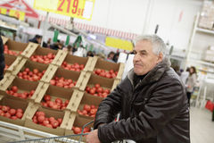 Senior man in vegetable shop Royalty Free Stock Photo