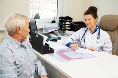 Senior man visiting doctor Stock Photography