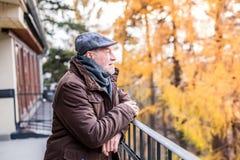 Senior man on a walk in town. Stock Photo