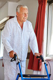 Senior man with walker in clinic Stock Photo