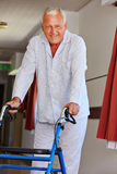 Senior man with walker in nursing Royalty Free Stock Photo