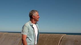 Senior man walking along the pier stock footage