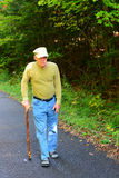 Senior man walking with cane Stock Photo
