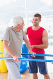 Senior man walking with coach help Stock Photography