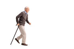 Senior man walking fast with a cane Stock Photography