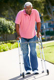 Senior Man With Walking Frame Stock Photo