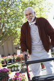 Senior Man With Walking Frame At Botanical Garden Stock Photos