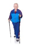 Senior man walking with hiking poles Royalty Free Stock Photography