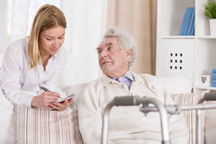 Senior man with walking problem. Picture of senior men with walking problem and his carer Stock Photos