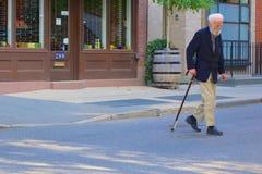 Senior man with walking stick Stock Photo