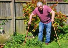 Senior man walking sticks or canes. Arthritis. Royalty Free Stock Images