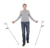 Senior man walking using crutches. Isolated on white Stock Images