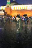 Senior man walks on the Red Square in Moscow. Stock Photo