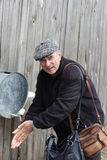 Senior man washes his hands Royalty Free Stock Image