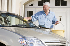 Senior man washing car Stock Photos