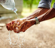 Senior man washing his hands Stock Images