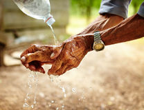 Senior man washing his hands Stock Photo