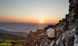 Senior man watches sunrise over blue ridge Royalty Free Stock Photo
