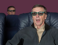 Senior man watching movie with 3d glasses Stock Photos