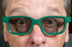 Senior man watching movie with 3d glasses Stock Photography