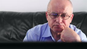 Senior man watching TV Royalty Free Stock Images