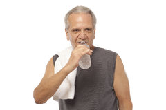Senior man with water bottle and towel Stock Photography