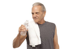 Senior man with water bottle and towel Stock Images