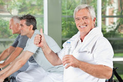 Senior man with water holding thumb Royalty Free Stock Photo